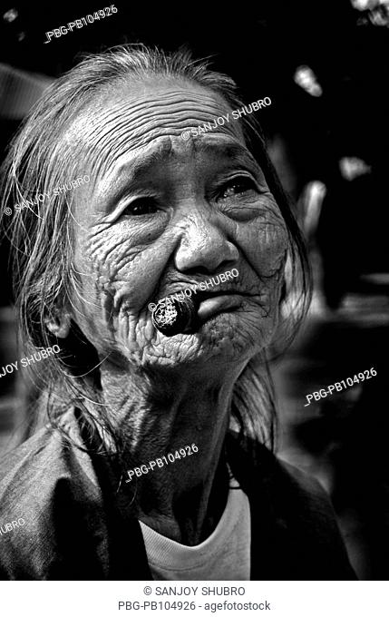 A tribal woman smokes Lama, Bangladesh December 24, 2008