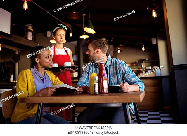 Waitress interacting with customer