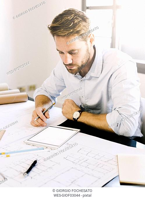 Architect working with tablet on desk