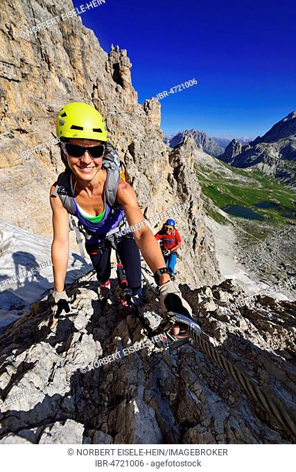 Hikers climbing the Paternkofel, via ferrata, Bödensee Lakes, Sexten Dolomites, Alta Pusteria, South Tyrol, Italy
