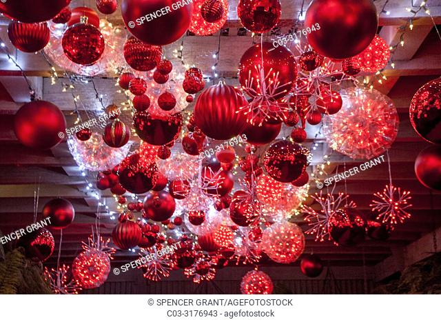 Huge Christmas tree balls shimmer in the ruby glow display in Newport Beach, CA.
