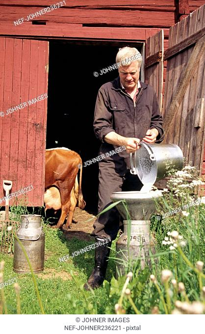 Man pouring milk into can