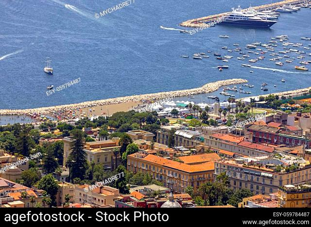 Naples, Italy - June 27, 2021: Aerial view of the boulevard and port on Tyrrhenian Sea in the Chiaia district on the Gulf of Naples