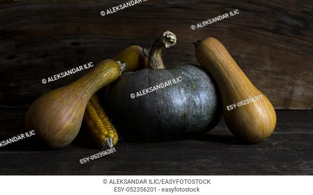 Pumpkin, Corncob and autumn leaves Decoration on a wooden table