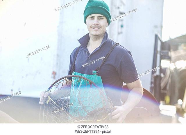 Fisherman working on trawler