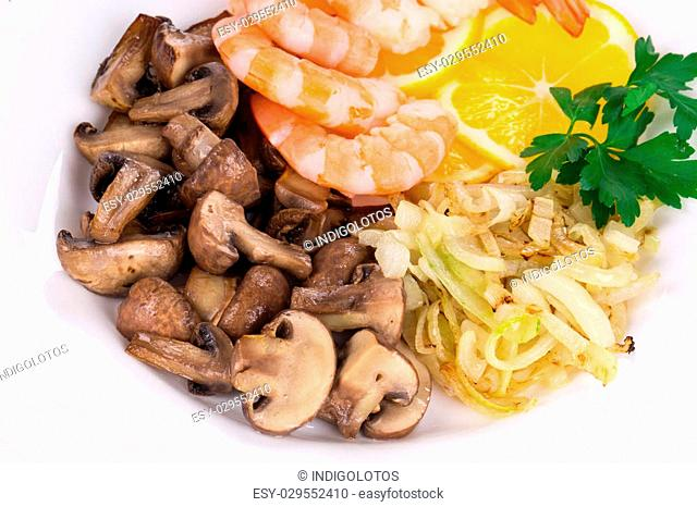 Shrimp salad with mushrooms as haute cuisine. Isolated on a white background