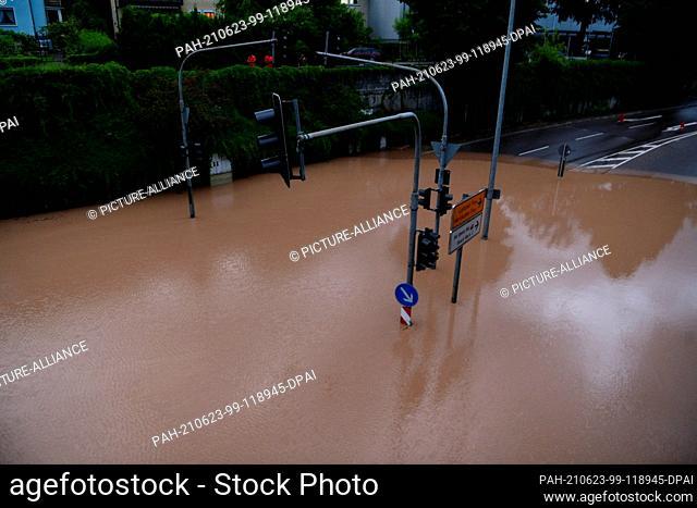 23 June 2021, Baden-Wuerttemberg, Schwäbisch Gmünd: High water in the city, a street is under water after heavy rainfall