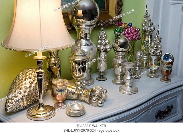 COLLECTION DISPLAY: Mercury glass vases, ornaments, on table top