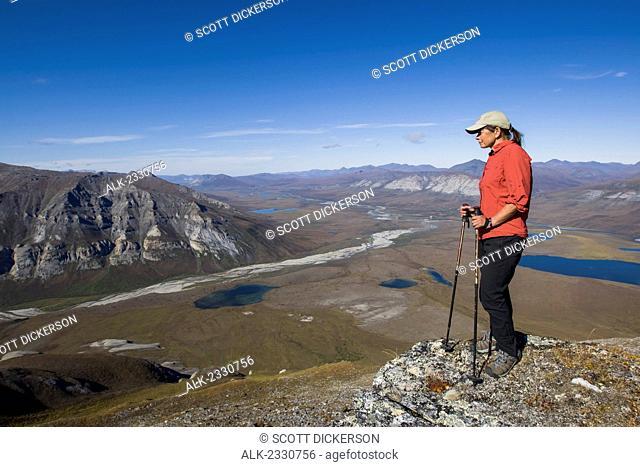 Hiker on ridge near Noatak River in the Brooks Range, Gates of the Arctic National Park, Northwestern Alaska, above the Arctic Circle, Arctic Alaska, summer