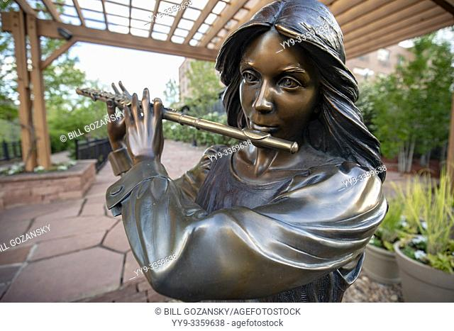 "Bronze Flutist Statue in public art piece entitled """"Joy of Music"""" by artist George Lundeen - Golden, Colorado, USA"