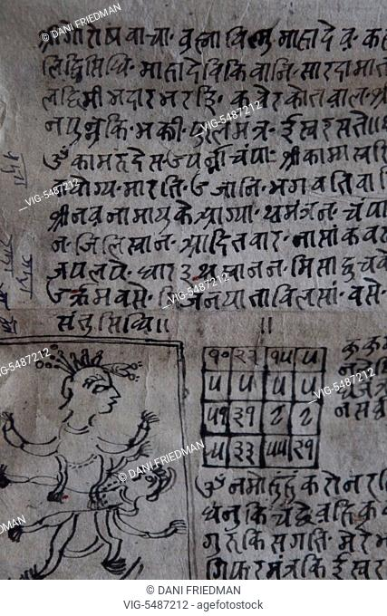 A page from an ancient Newari astrology and religious text in Panauti, Nepal. - PANAUTI, NEPAL, 11/12/2011