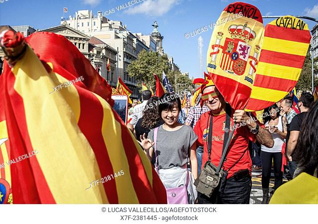 Anti-independence Catalan protestors carry Spanish flags and catalan flags during a demonstration for the unity of Spain on the occasion of the Spanish National...