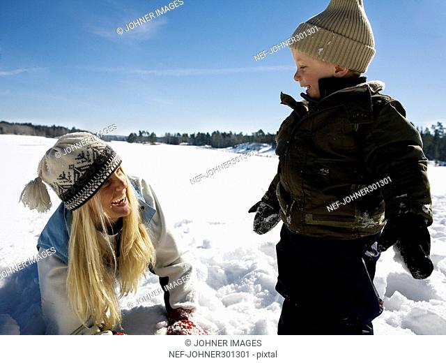 Siblings playing in snow