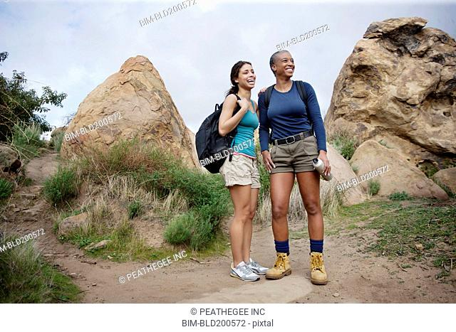 Mother and daughter hiking together