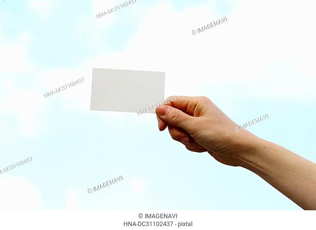 Woman Hand Holding Business Card