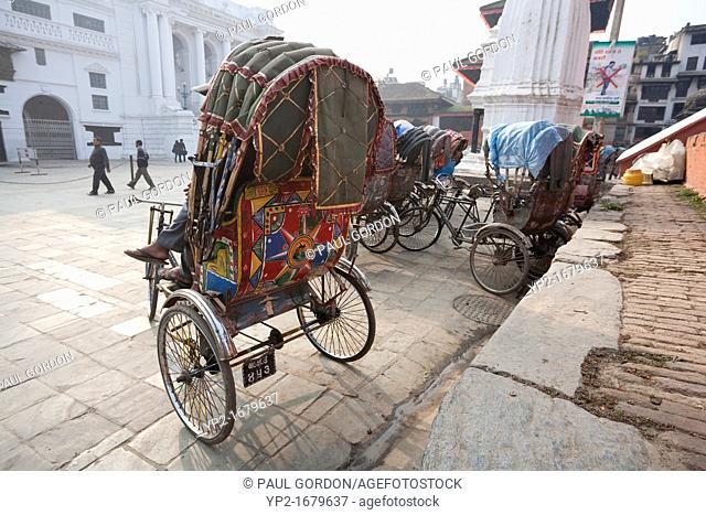 Rickshaw drivers waiting for customers in front of Maju Deval in Durbar Square - Kathmandu, Bagmati Zone, Kathmandu Valley, Nepal