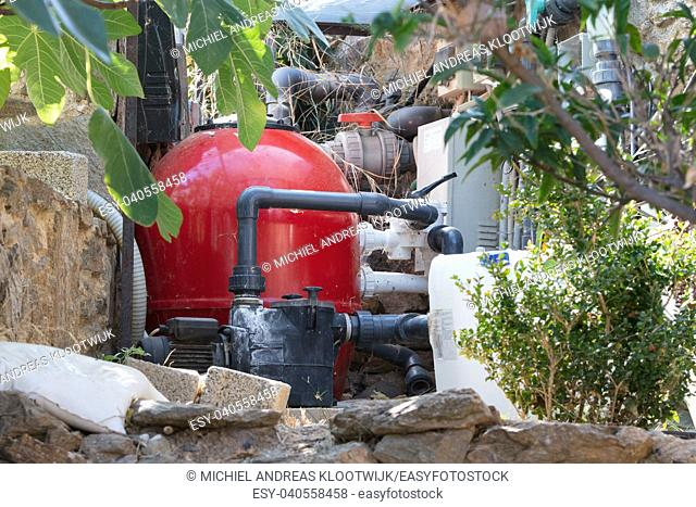 Expansion tank heating system in a garden in Greece