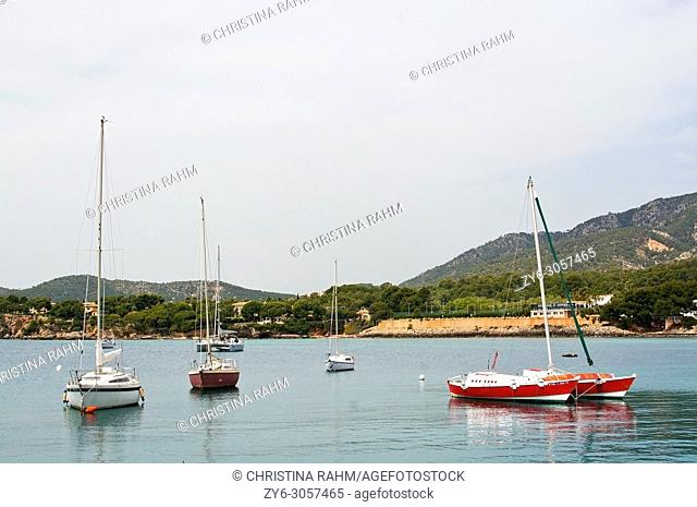 Luxury yachts moored in the marina of Puerto Portals on an overcast day in Mallorca, Spain