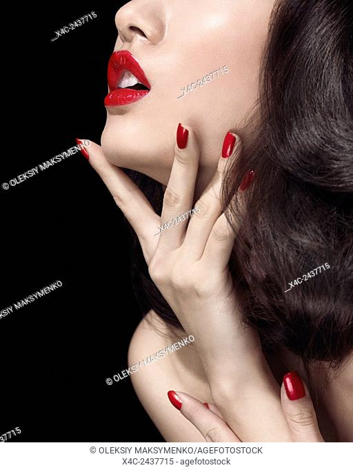 Artistic sensual closeup of a young woman mouth with bright red lipstick