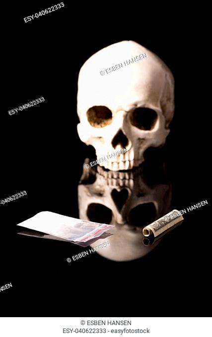 cocaine, Herion or other illegal drugs that are sniffed by means of a tube or injected with a syringe, money and Skull, isolated on black glossy background