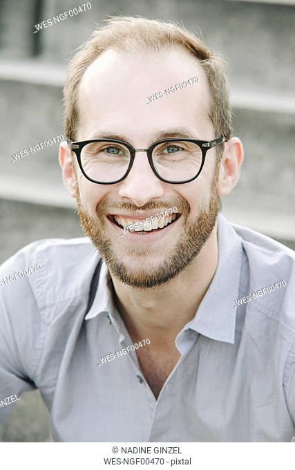 Portrait of laughing businessman wearing glasses