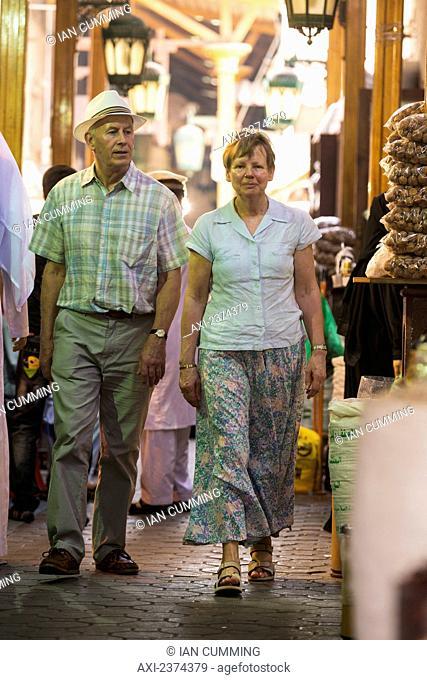 Western couple walking through the spice souk; Dubai, United Arab Emirates