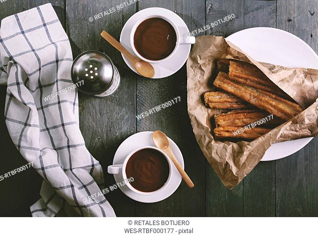 Churros with cups of hot chocolate