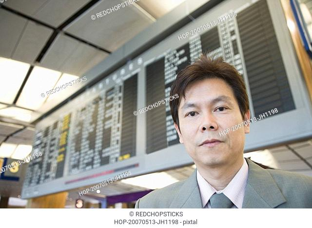 Portrait of a businessman at an airport