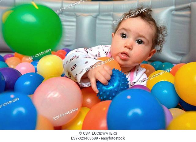 Baby plays with colorful balls