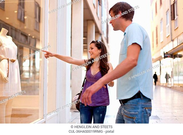 Woman window shopping with boyfriend