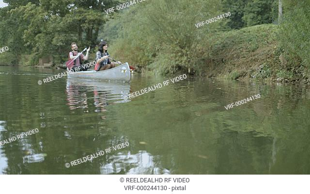 Couple rowing boat in lake