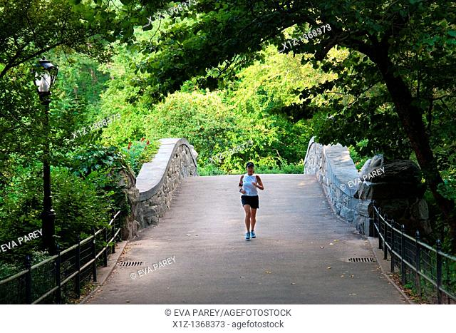 A sportswoman running in Central Park in Uptown Manhattan New York City