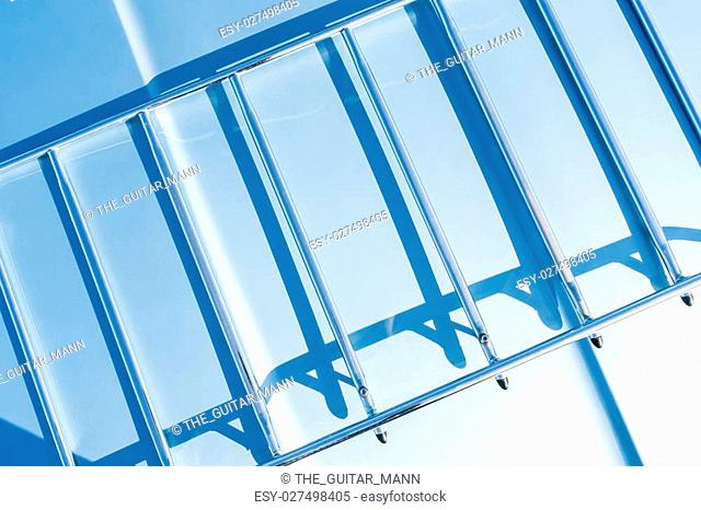 abstract of shadows on a metal frame in strong sunlight