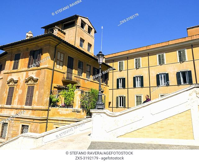 Building facade facing the Spanish Steps (Scalinata di Trinitá dei Monti) between Piazza di Spagna at the base and Piazza Trinitá dei Monti - Rome, Italy