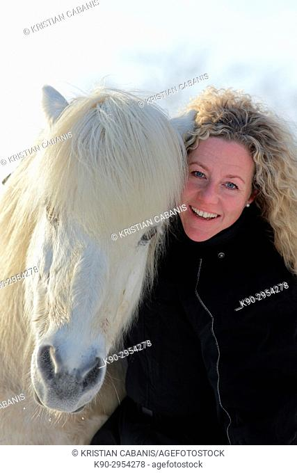 Young blond woman with Icelandic horse, Attenbach, Siegerland, North-Rhein-Westphalia, Germany, Europe