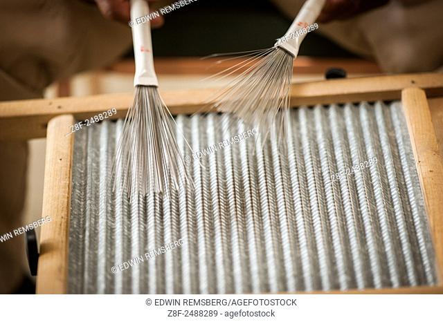 homemade musical instrument using wire brushes in Baltimore, Maryland. USA