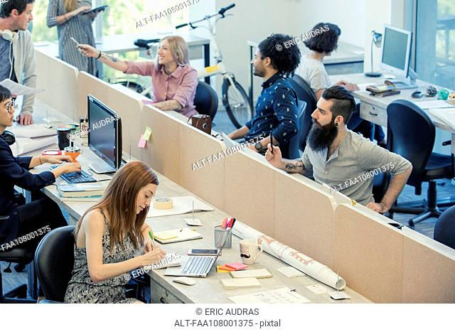 Professionals coworking in shared office space