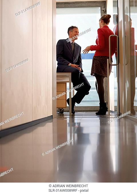 Two people in group Meeting in Office