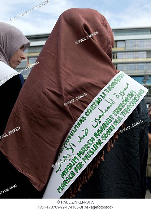 Participants in the 'Muslim March Against Terrorism' demonstration in Berlin, Germany, 9 July 2017. A group of 30 Muslims took part in an initiative started by...