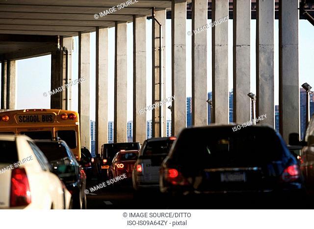 Traffic under urban overpass