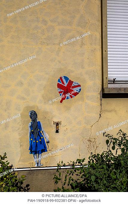 18 September 2019, France (France), Straßburg: A so-called stencil sticks to a house wall near the European Parliament. Photo: Philipp von Ditfurth/dpa