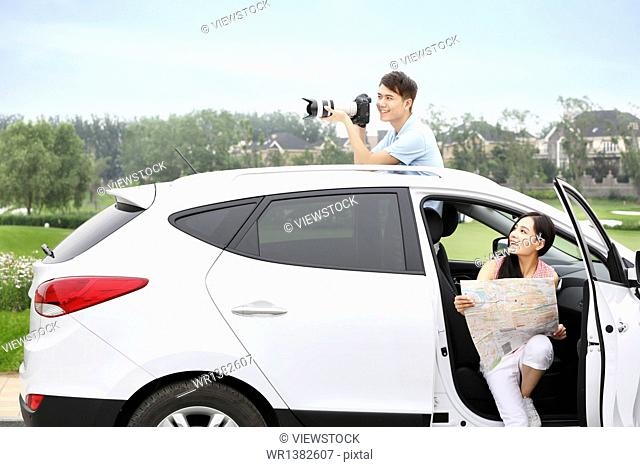 Young couple driving trips