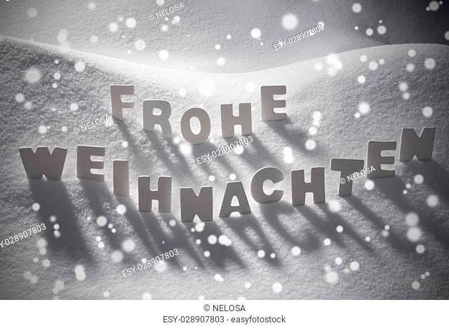White Wooden Letters Building German Text Frohe Weihnachten Means Merry ChristmasSnow And Snowy Scenery, Snowfalkes. Christmas Atmosphere