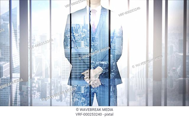Businessman with city and skyscraper overlay