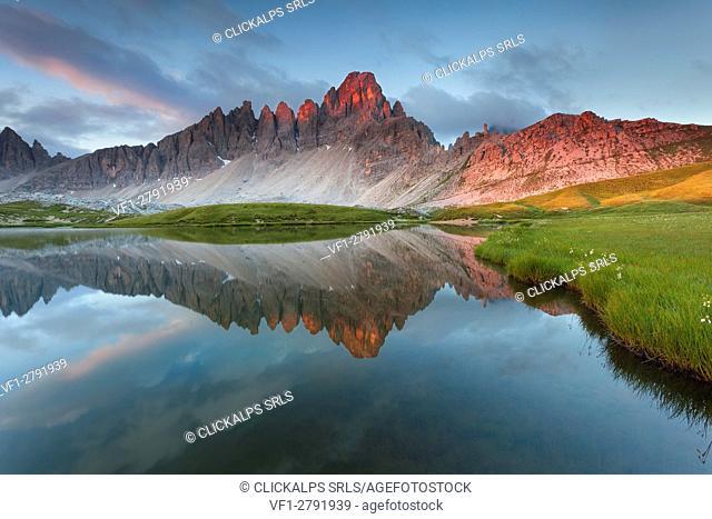 Monte Paterno, Dolomites, Italy. The mountain reflects onlaghi dei Piani, alpine lakes, at sunrise