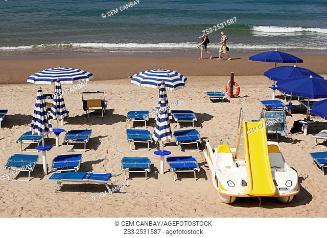 Parasols and sunbeds at the sandy beach, Cefalu, Sicily, Italy, Europe