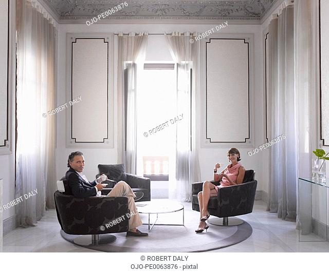 Couple relaxing in modern hotel suite