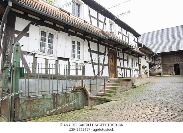 Traditional half-timbered houses in the streets of the small town of Hunspach in Alsace, on May 13, 2016 in France