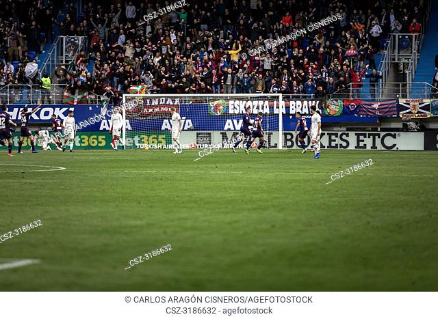Real Madrid players look as Eibar players celebrate the third goal in the La Liga match between Eibar and Real Madrid CF at Ipurua Stadium on November 24