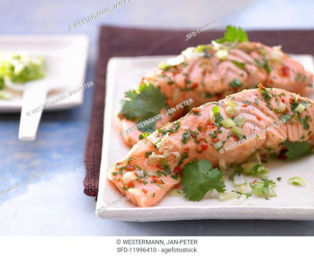 Steamed fillets of salmon with chilli and coriander